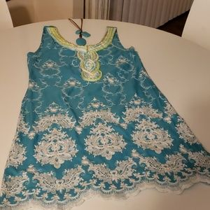Chic turquoise and white mini dress